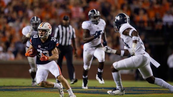 Auburn wide receiver Will Hastings (33) runs downfield