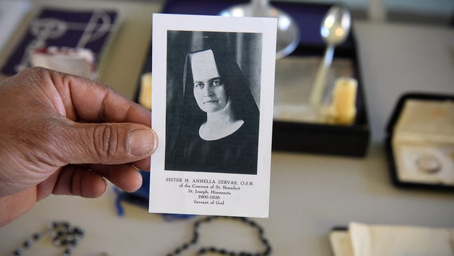 Patrick Norton holds a photograph of Sister M. Annella Zervas Tuesday, Oct. 24, at his home in St. Joseph.