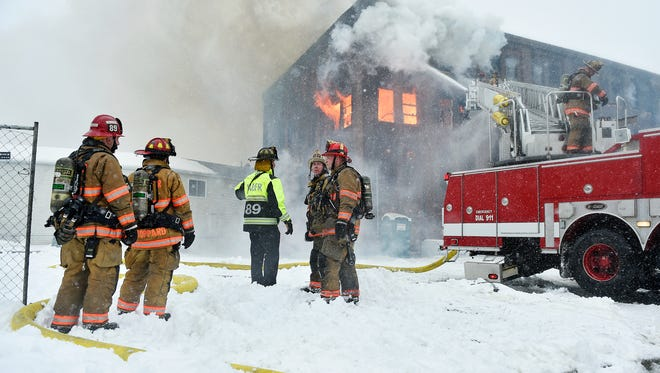 Flames shoot from the windows as firefighters work on the scene of a fire Wednesday at the old Weaver Organ and Piano building in York. The building was under renovation to be converted into a residential complex.