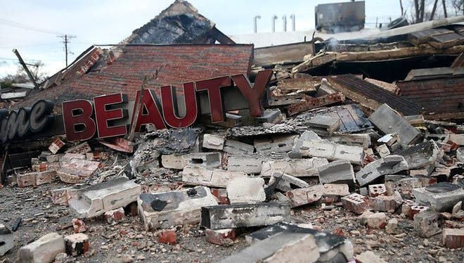 A sign sits amid rubble at a building that was damaged during a demonstration on November 25, 2014 in Dellwood.