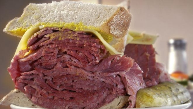 The famous tall and thick corned beef sandwich with cheese and mustard on rye bread is one of four sandwich offerings at the Shapiro's location at Indianapolis International Airport, which sells about 600 sandwiches a day.