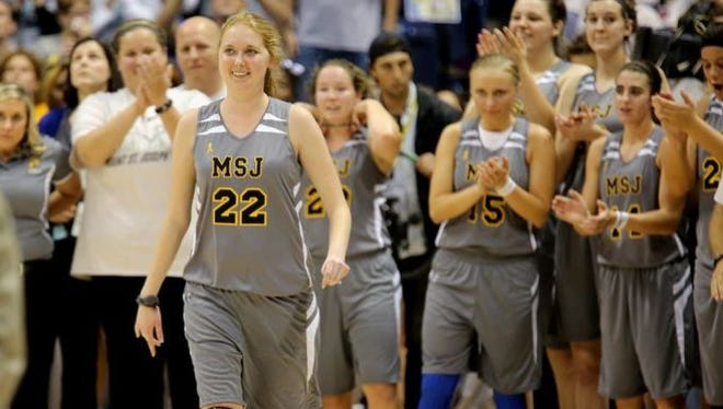 Lauren Hill took part in her first college basketball game against Hiram College at Xavier University's Cintas Center.