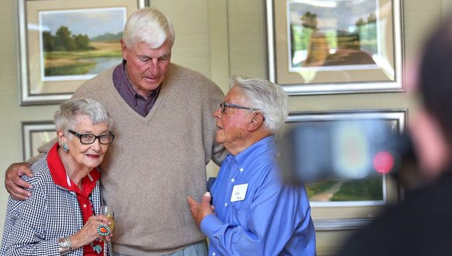 Coach Bob Knight, center, meets and greets guests, including Rosalind McCart, left, and Ned Hugus, before speaking at The Barrington of Carmel, a retirement community, Wednesday, May 6, 2015.