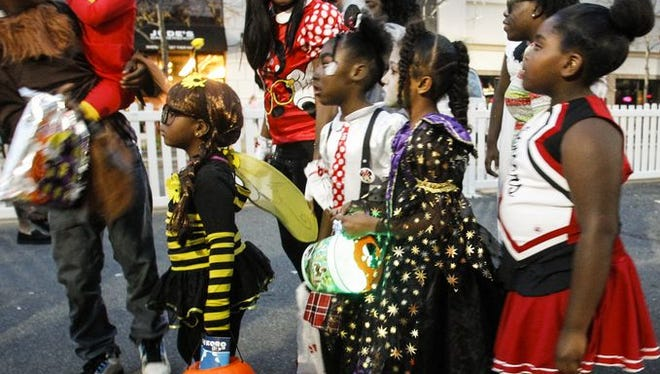 Youngsters descended upon Washington Square in downtown Lansing for the 7th Annual Trick-or-Treat on the Square, Monday, Oct. 27, 2014.