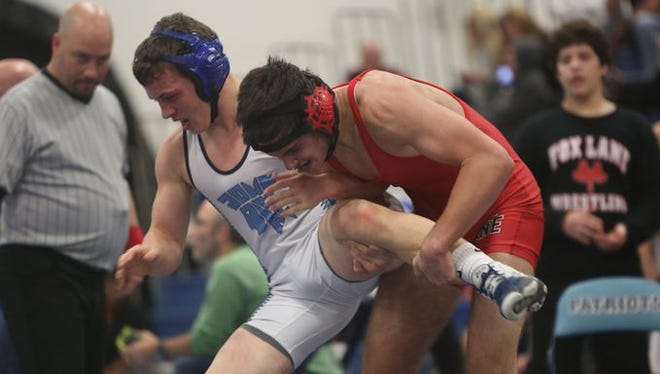 Fox Lane's Jake Witz on his way to defeating John Jay's Thomas Lavigne in the 152-pound weight class during the finals of the Patriot wrestling tournament at John Jay High School in Hopewell Junction Dec. 12, 2015.