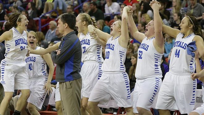 Assumption players react after the Royals defeated Barneveld in Saturday's WIAA Division 5 championship game at the Resch Center in Ashwaubenon.