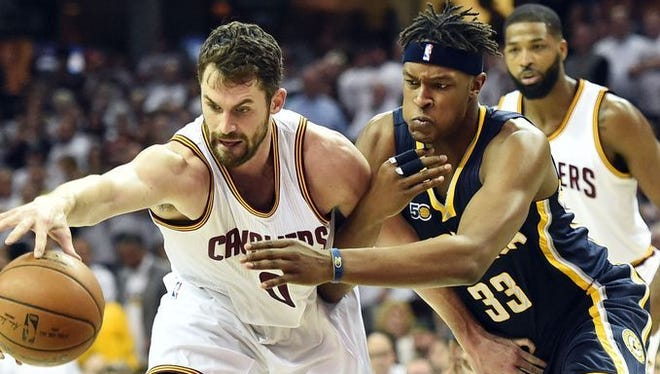 Kevin Love and Myles Turner battle for the ball during the first half of the Pacers and Cavaliers playoff game on Monday, April 16, 2017