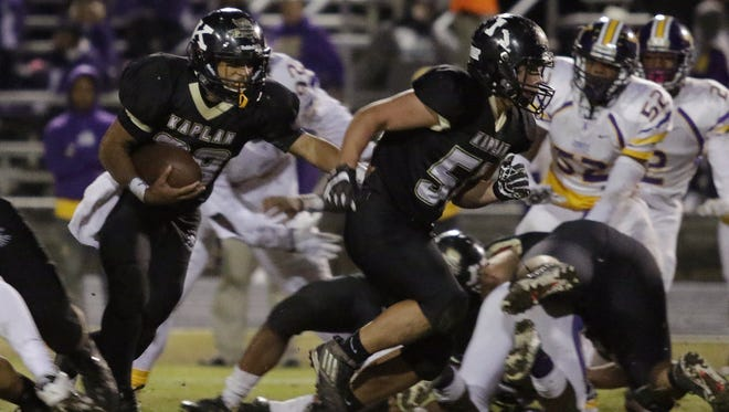 Kaplan's Austin Stelly leads the way for running back Mac Thibeaux in the second quarter as Kaplan faces off against Amite on Friday night in the Class 3A state semifinal game in Kaplan.
