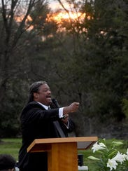 Christopher Battle of Tabernacle Baptist Church delivers the sermon as the sun rises at a community Easter sunrise service at the Knoxville Botanical Garden and Arboretum.