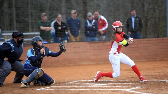 Enka catcher Jordan Harris, left, awaits a pitch during a March 11 game with Erwin.