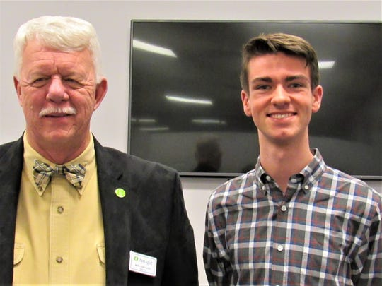 At a community meeting earlier in the year, Ron Williams and MPC Youth Representative Jack Coker discussed town issues with residents.