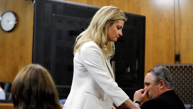 Sportscaster and television host Erin Andrews walks past a television monitor set up for jurors Thursday in Nashville as she leaves the courtroom before jurors watched nude videos of Andrews that a stalker secretly recorded.