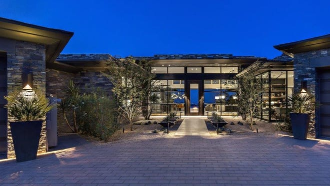 James Benson, former CEO of John Hancock Life Insurance, and his wife, Marlene, purchased this 7,548-square-foot contemporary-style mansion in Scottsdale's Desert Mountainneighborhood for $9.2 million.