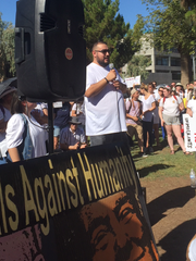 Rigo Gonzalez address protesters at a rally at the Arizona Capitol