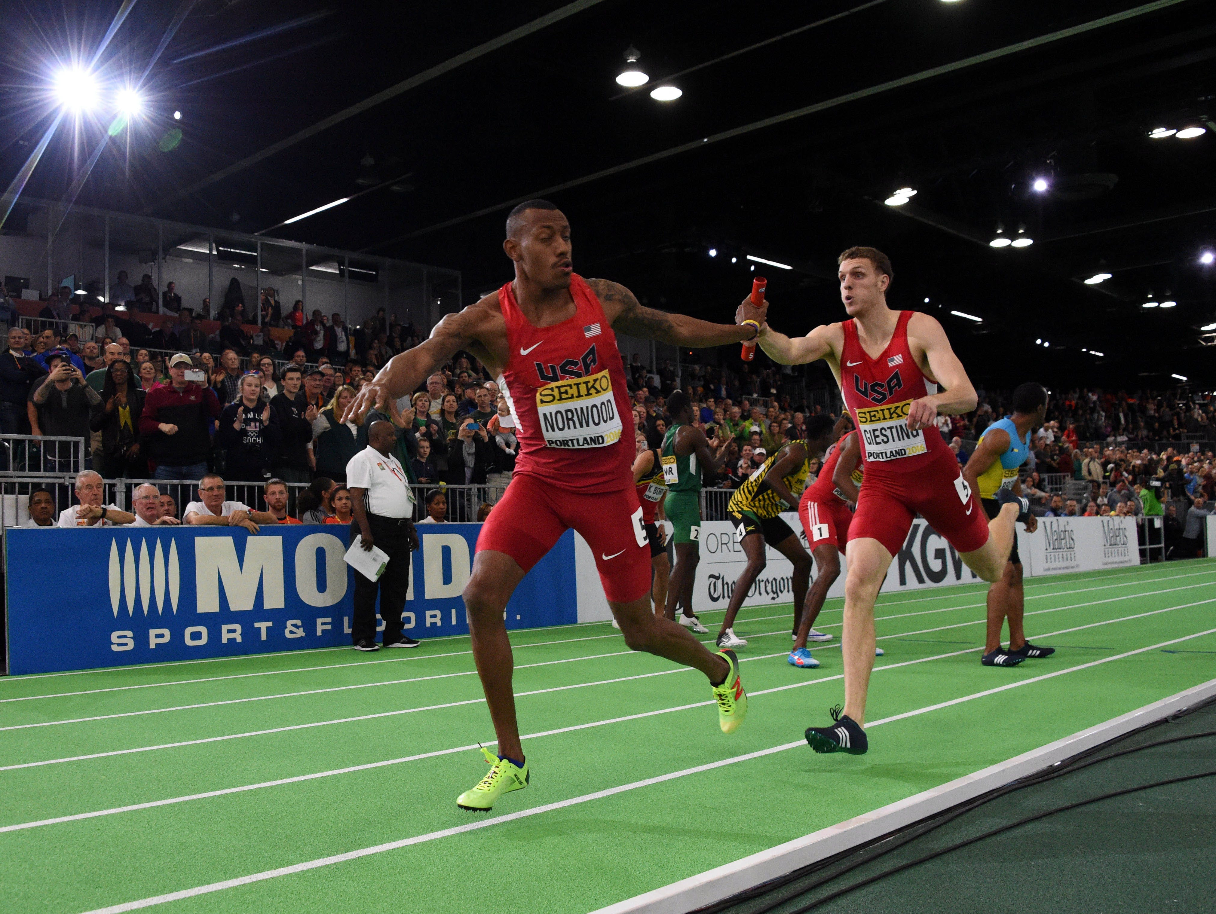 Vernon Norwood takes the handoff from Chris Giesting on the anchor leg of the victorious United States 4 x 400m relay that won in 3:02.45 for the No. 3 mark on the all time list during the 2016 IAAF World Championships in Athletics at the Oregon Convention Center.