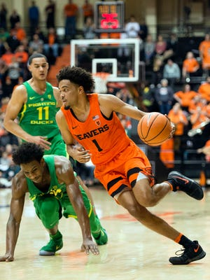 Jan. 5, 2018; Corvallis, OR, USA; Oregon State guard Stephen Thompson Jr. (1) drives past Oregon forward Abu Kigab (24) during the second half in a Pac-12 matchup at Gill Colisum. The Beavers won 76-64. Credit: Troy Wayrynen-USA TODAY Sports