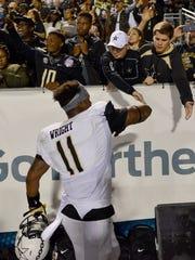 Vanderbilt linebacker Charles Wright (11) slaps hands