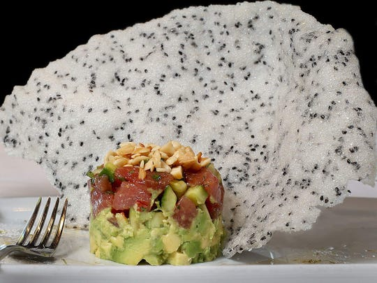 Ahi Poke with avocado napoleon, chili oil, lime, sea-salt