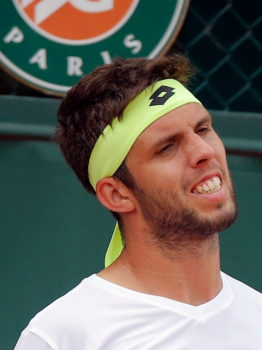 Jiri Vesely of the Czech Republic grimaces as he plays Jack Sock of the U.S.during their first round match of the French Open tennis tournament at the Roland Garros stadium, Monday, May 29, 2017 in Paris. (AP Photo/Michel Euler)