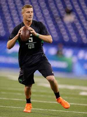 Connor Cook gets ready to deliver the football during the NFL combine on Saturday.