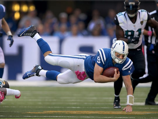 Indianapolis Colts quarterback Matt Hasselbeck (8) is tripped up by Jacksonville Jaguars cornerback Aaron Colvin (22) in the second half of their game. The Indianapolis Colts play the Jacksonville Jaguars Sunday, October 4, 2015, afternoon at Lucas Oil Stadium.