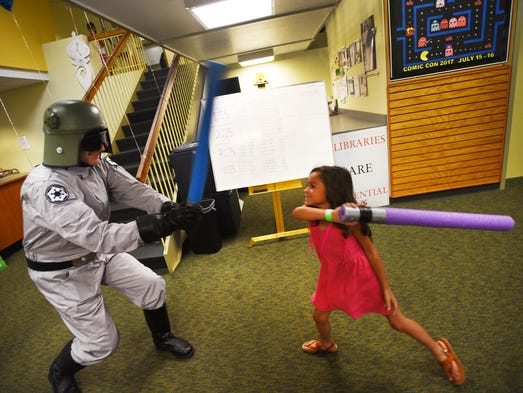 Elyse Hansen (age 6) of Bergenfield, battles with Steve
