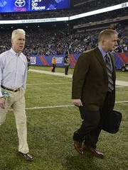 Green Bay Packers general manager Ted Thompson and Russ Ball, vice president of football administration, walk across the field after a game.
