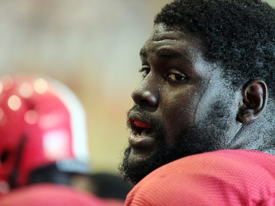 UL defensive lineman Sherard Johnson (97) participates in practice Tuesday at the Leon Moncla Indoor Practice Facility.