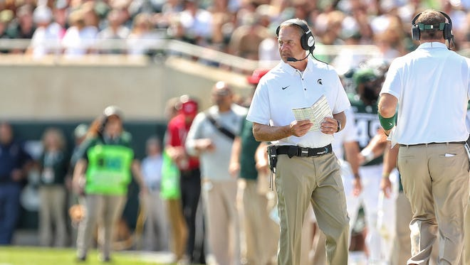 Michigan State Spartans head coach Mark Dantonio stands on the field during the first quarter of a game against the Bowling Green Falcons  at Spartan Stadium.