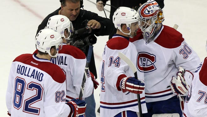 Montreal Canadiens center Tomas Plekanec and goalie Peter Budaj celebrate after defeating the New York Rangers at Madison Square Garden.