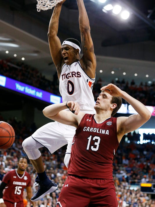 Auburn forward Horace Spencer (0) scores against South Carolina forward Felipe Haase during the second half of an NCAA college basketball game, Saturday, March 3, 2018, in Auburn, Ala. (AP Photo/Brynn Anderson)