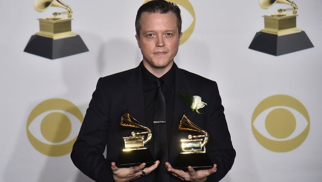 """Jason Isbell poses in the press room with the best American roots song award for """"If We Were Vampires"""" and the best Americana album award for """"The Nashville Sound"""" at the 60th annual Grammy Awards at Madison Square Garden on Sunday, Jan. 28, 2018, in New York."""