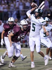 Dowling's Tom Derry (68) puts presure on Sioux City