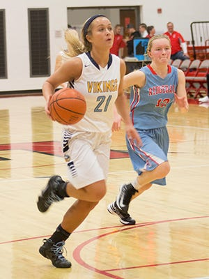 Kendall Stuckman of River Valley drives to the basket against Ridgedale during the Marion County Tournament earlier this season. Stuckman was named Fahey Bank Athlete of the Month for December.