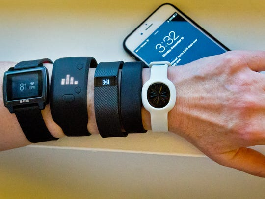 Fitness trackers, from left, Basis Peak, Adidas Fit