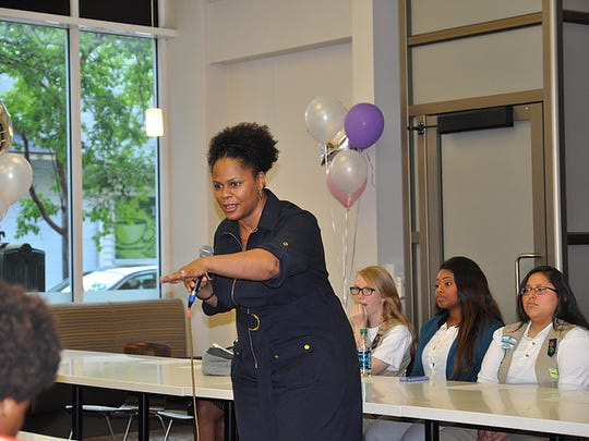 Women from the community teach girls about career opportunities at a previous Ladies Learning to Lead conference. The group is teaming with 100 Black Men of Tallahassee to serve more young people.