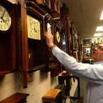 Rick Enge and his new dog at the World of Time clock shop in downtown Great Falls.