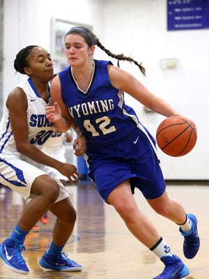 Wyoming senior Emily Wadds drives to the basket against Summit Country Day. Wadds has had to take over the Cowboys' scoring with the injury to point guard Ashli O'Neal.