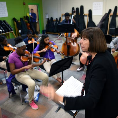 "Isaiah T. Creswell Middle Arts Magnet music teacher Beth Voltz directs students while playing the song ""Thriller"" during strings class on Thursday, Nov. 5, 2015."