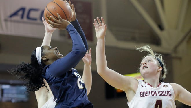 Notre Dame guard Arike Ogunbowale, front left, takes a shot over the arms of Boston College guard Taylor Ortlepp (4), of Australia, in the second half of an NCAA college basketball game, Sunday, Feb. 18, 2018, in Boston. Notre Dame won 89-55.