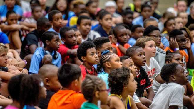 """Dozens of kids listen as they are given advice and instruction at the start of the Mitchell """"JJ"""" Anderson and Dana J. Davis Basketball Camp on Monday, July 15, 2019 at the Peoria Civic Center."""