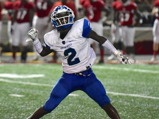 Raequan Prince celebrates a Winton Woods Warriors' victory over La Salle Friday, September 22nd at LaSalle High School