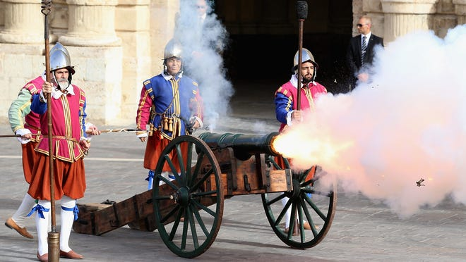 Soldiers fire canon during re-enactment pageant in St George's Square in Valletta, Malta, during Prince William's official visit, Sept. 20.