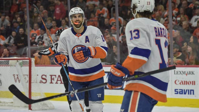 Andrew Ladd, left, had the game-tying goal midway through the third period. The Islanders finished the job in overtime.