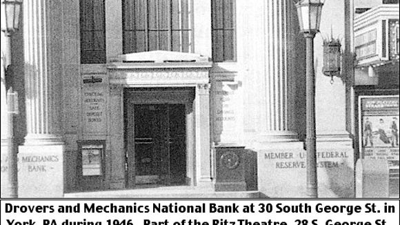 Drovers and Mechanics National Bank at 30 South George Street in York, PA, during 1946.  Part of the Ritz Theatre, 28 South George Street, can be seen at the extreme right. (Photo from collection of York County History Center)