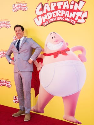 Ed Helms poses with his superhero doppelganger at the Los Angeles premiere of 'Captain Underpants: The First Epic Movie.'