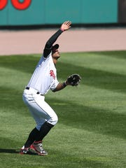 Red Wings left fielder Adam Brett Walker shield his eyes from the bright sun to catch a fly ball in April in Rochester.