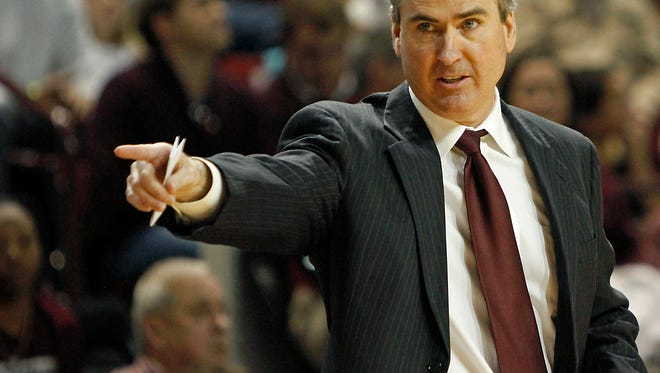 Then-Mississippi State head coach Rick Stansbury directs his team during  an NCAA college basketball game in Starkville, Miss., Saturday, Feb. 11, 2012.