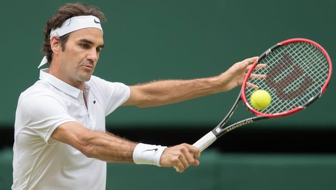 Federer in action during his match against Milos Raonic at Wimbledon.