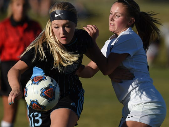 Reed's Grace Newlin, left, looks to beat Galena's Peyton
